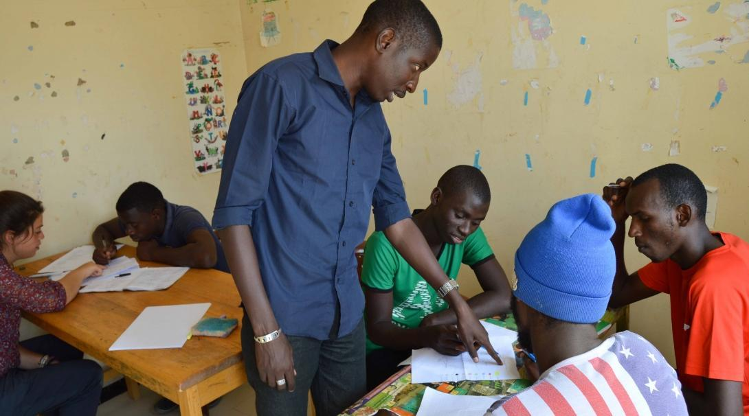 An intern works with members of a local community during his Micro-finance internship in Senegal.
